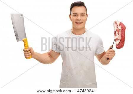 Young butcher holding a cleaver and a fork with a steak isolated on white background