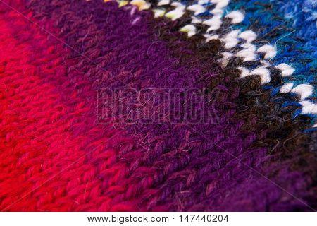 striped colorful wool texture handmade patten closeup macro blue red  purple orange brown white
