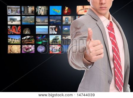 Businessman  over perspective TV screen wallpaper