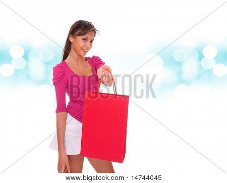 a Shopping sexy woman over blue bokeh background