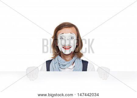 mime actor joyfully holding a blank white billboard