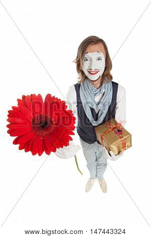 Mime Artist holds out red flower - red gerber and holding a gift