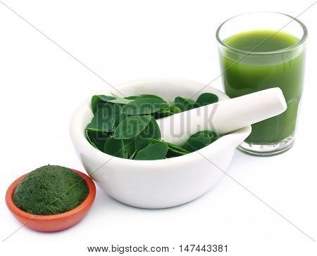 Edible moringa leaves with extract and ground paste