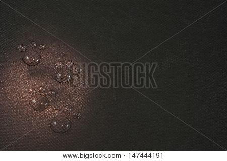 Four water footprints in red light on black background