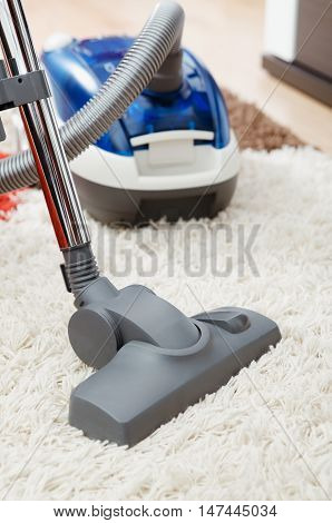 Vacuum Cleaner On Shaggy Carpet Inside Room