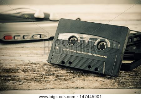 Old casette tape player. Retro style photo on wooden background