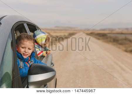 little rland g travel by car on the road, family travel