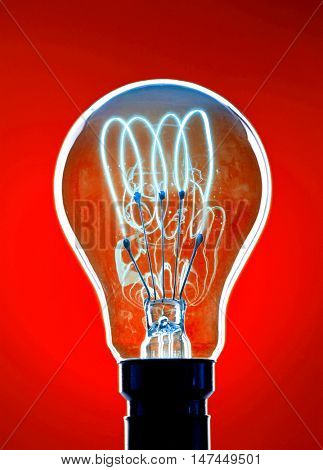 Light Bulb over red background
