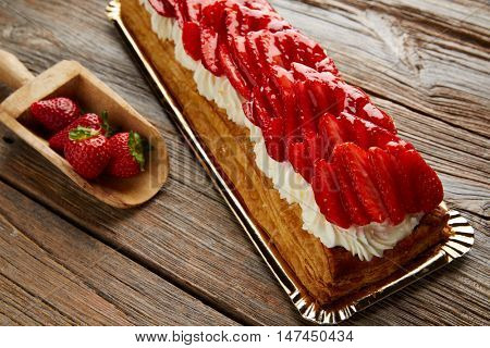 Strawberries puff pastry pie on wooden table