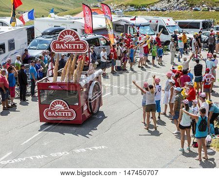 Col du Glandon France - July 23 2015: Banette vehicle during the passing of the Publicity Caravan on Col du Glandon in Alps during the stage 18 of Le Tour de France 2015. Banette is the leading brand for the artisan bread in France.