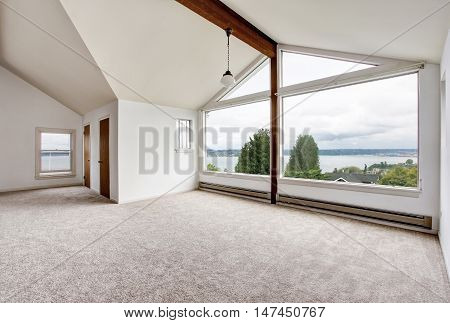 Empty Hallway Interior With Carpet Floor, Big Window And Perfect Water View