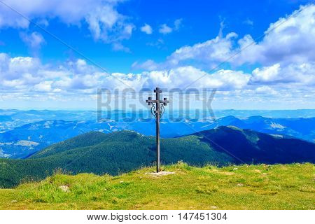 Cross on the top of Pip Ivan mountain nature landscape in Carpathians Ukraine