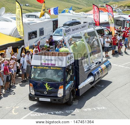 Col du Glandon France - July 23 2015: Bostik vehicle during the passing of the Publicity Caravan on Col du Glandon in Alps during the stage 18 of Le Tour de France 2015. Bostik is a leading global adhesive specialist in industrial manufacturing constructi