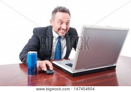 Man At Office With Psychotic Look Having Energy Drink