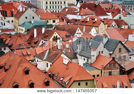 Fragment of panoramic view of Cesky Krumlov Czech Republic with landmarks. Red tiled roofs decorative gables of old houses in perspective.