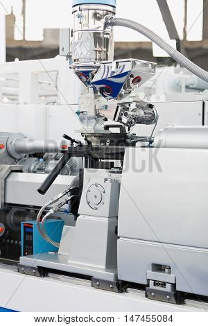 Hydraulic injection molding machine, color image, close up