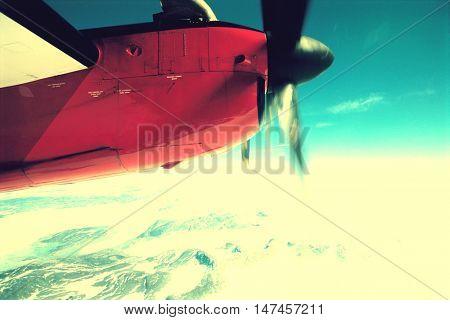 Plane Flying over Snowy Landscape