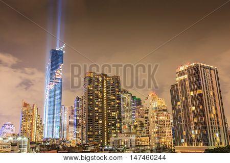 Bangkok Thailand- August 29 2016: Mahanakorn skyscraper the tallest building in Thailand and nightlight cityscape in Bangkok.