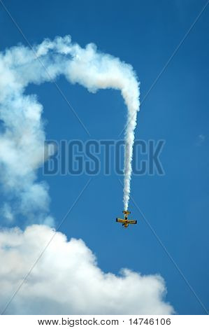 Biplane during aerobatic maneuver