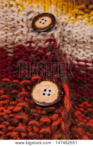 striped colorful wool texture handmade patten closeup macro  red  yellow  orange beige buttons