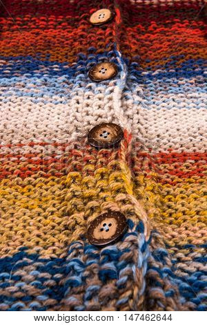 striped colorful wool texture handmade patten closeup macro blue red  yellow  orange beige buttons