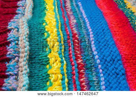 striped colorful wool texture handmade patten closeup macro blue red green yellow pink purple