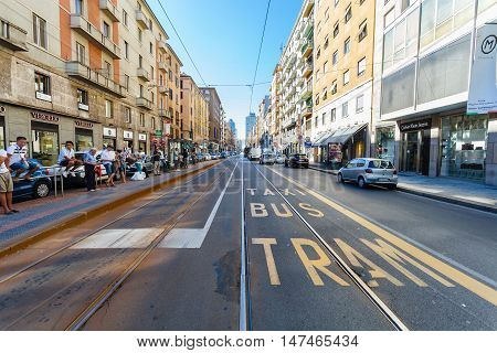 MILAN, ITALY - September  06, 2016: A view of bus, train, taxi station on the Tunisia street (Viale Tunisia) and part of road for public transport with title Taxi, Bus, Tram