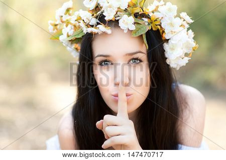 Woman in the forest with flowers shushing