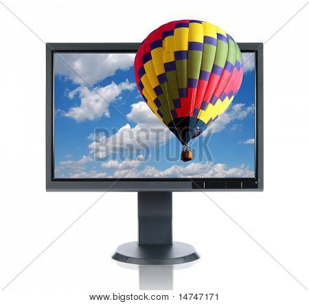 LCD monitor and hot air balloon isolated over a white background