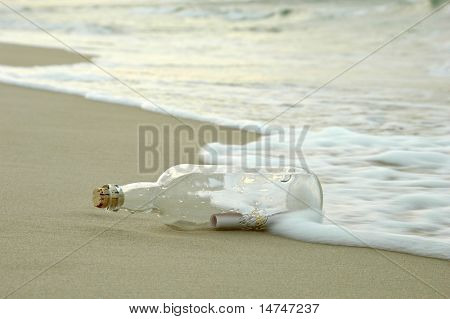 Message in a bottle being hit by the waves on a distant shore