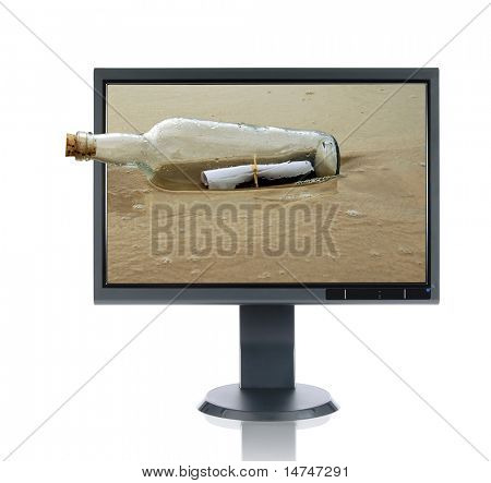 LCD monitor and message in a bottle isolated over a white background