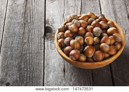 Filbert In Bowl On A Dark Wooden Background