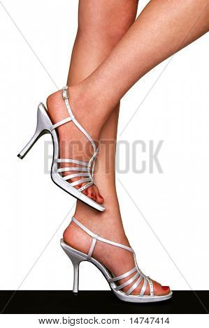 Legs with silver High Heels isolated over a white background