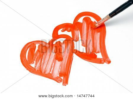 Two Painted hearts with brush isolated over a white background