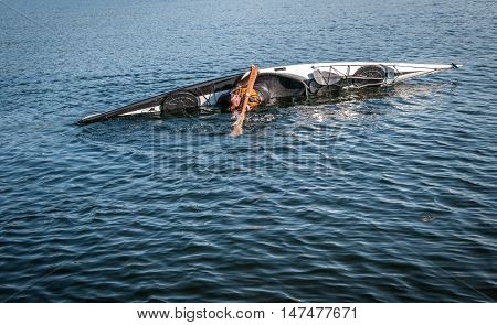 man rolling with a kayak on a lake - serial pictures 4 of 11