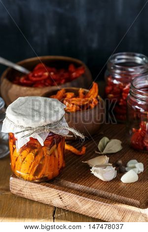 Sun-dried Tomatoes With Herbs And Garlic On Wooden Desk