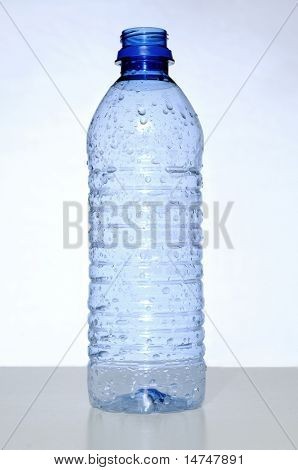 Empty water bottle over a neutral background