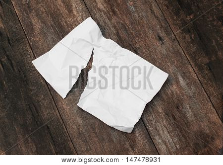 paper sheet note rip and crumpled on a wooden floor soft-focus : with copy space for add text above and may be used as background :