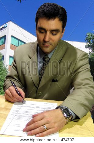 Executive Signing A Contract