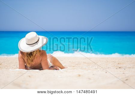 WOman on The famous Navagio Shipwreck beach in Zakynthos island Greece