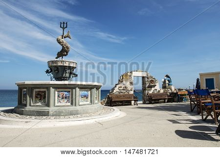 Fountain of Neptune in Diafani a tranquil holiday seaside village on the island of Karpathos Dodecanese islands Greece