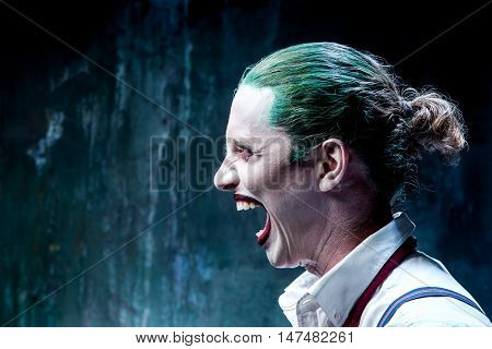 Bloody Halloween theme: The crazy joker face on black background
