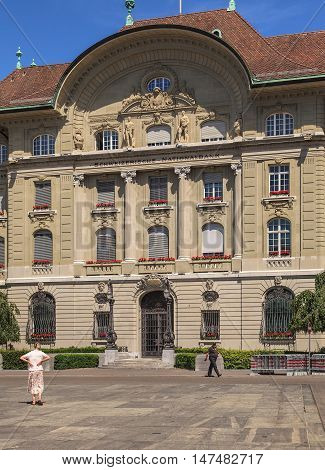 Bern, Switzerland - 11 June, 2014: facade of the Swiss National Bank building, view from Bundesplatz square. The Swiss National Bank (SNB) is the central bank of Switzerland it is responsible for the monetary policy of the country.