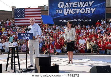 O'FALLON - AUGUST 31: Senator McCain speaks as Saran Palin looks on at a rally in O'Fallon near St. Louis, MO on August 31, 2008