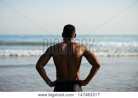 Black Sportsman Ready For Swimming Into The Sea