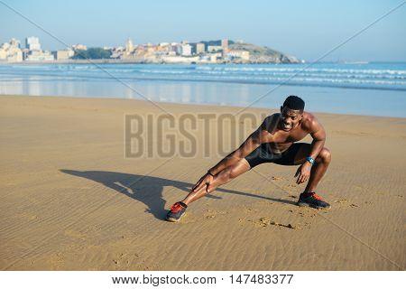 Runner Stretching Legs Before Running