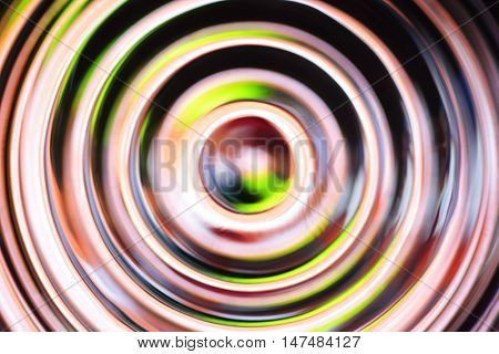 Yellow - black abstract background with defocused concentric circles