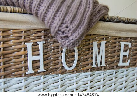 wattled box with wool pullover and title home