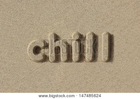 Chill written in sand letters. Very simple and graphic.