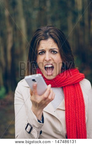 Upset Woman Shouting To Smartphone